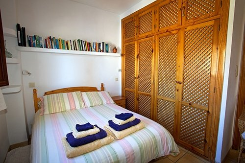 comfortable light bedrooms in our holiday apartment in Bubión in the Alpujarras